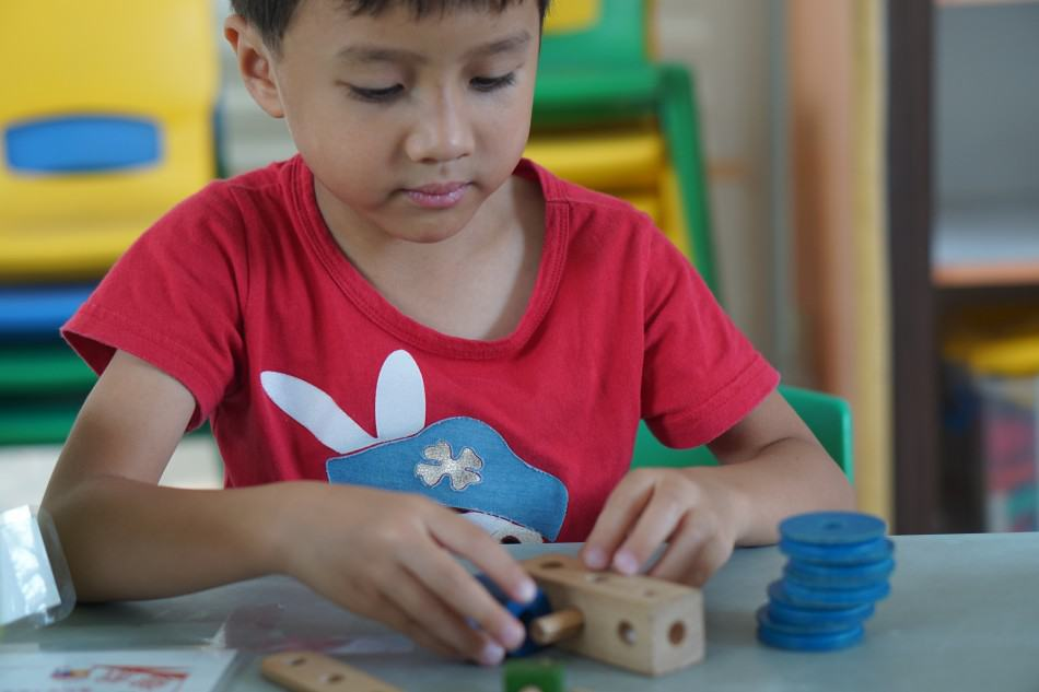 playing with blocks and working