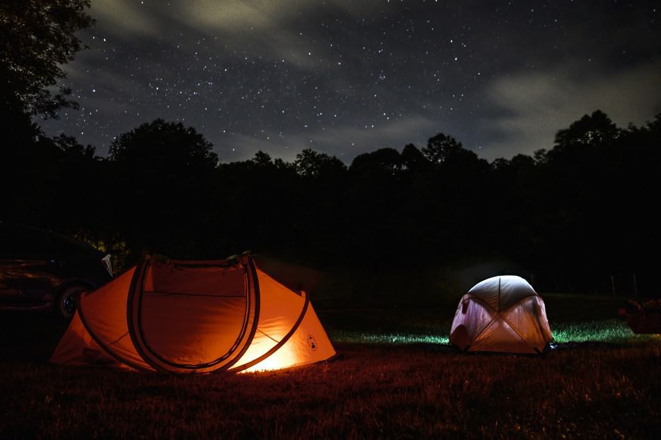 two-lighted-dome-tent-during-nighttime